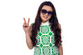 Asian woman with sunglasses making peace sign Royalty Free Stock Photo