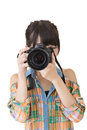 Asian woman takes images with photo camera Royalty Free Stock Photo