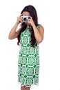 Asian woman taking picture with digital camera Royalty Free Stock Photo