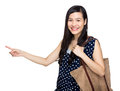 Asian woman with tote bag and finger point out isolated on white Royalty Free Stock Image
