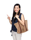 Asian woman with tote bag and finger point out isolated on white Stock Photo