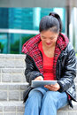 Asian woman use tablet young out of modern building Royalty Free Stock Photo