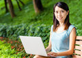 Asian woman using laptop at outdoor Royalty Free Stock Image