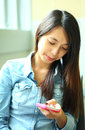 Asian woman using smartphone on the street Royalty Free Stock Photography