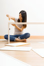 Asian woman using strew drive for assembling closet at home Stock Images