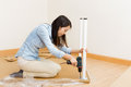 Asian woman using strew driver for assembling furniture at home Royalty Free Stock Photography