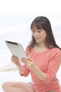 Asian woman using Tablet PC Royalty Free Stock Photo