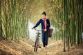 Asian woman walk alone on an ancient bicycle. Royalty Free Stock Photo