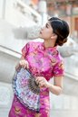 Asian woman wearing a cheongsam chinese costumes Stock Photography