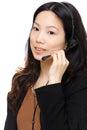 Asian woman wearing headset Royalty Free Stock Photos