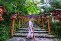 Asian woman wearing japanese traditional kimono at Kifune Shrine in Kyoto, Japan Royalty Free Stock Photo