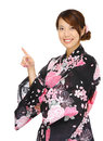 Asian woman wearing kimono and pointing up isolated on white Stock Photo