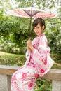 Asian woman wearing a yukata in japanese style garden chinese lady kimono traditional Stock Photo