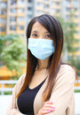 Asian woman wears face mask wearing Royalty Free Stock Photos