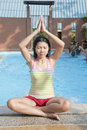 Asian woman in Yoga position Royalty Free Stock Photo