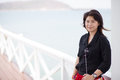 Asian women black jacket woman smiling stood on a bridge made ​​of wood Royalty Free Stock Photography