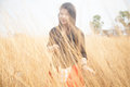 Asian women black shirt standing in a meadow woman hot dry arid grassland Stock Photos