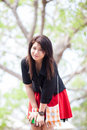Asian women black shirt standing under a tree woman happy smiling relaxing in the park Royalty Free Stock Photos