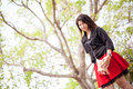 Asian women black shirt standing under a tree woman happy smiling relaxing in the park Stock Image