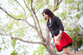 Asian women black shirt standing under a tree woman looking forward Royalty Free Stock Image