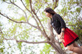 Asian women black shirt standing under a tree woman looking forward Stock Photography