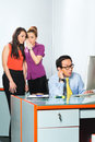 Asian women bullying colleague in office or employee s tattle or whisper about or man him the Royalty Free Stock Photo