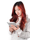 Asian women red long hair in modern fashion woman with color using tablet Royalty Free Stock Photography