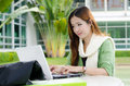 Asian women student with computer laptop beautiful young smiling after interview job success Royalty Free Stock Photo