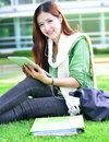 Asian women student learning with computer tablet beautiful young woman Royalty Free Stock Photo