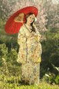Asian women wearing traditional japanese kimono and red umbrella Royalty Free Stock Photo