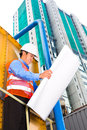 Asian worker or supervisor on building site chinese construction architect with clipboard a in asia Stock Photo