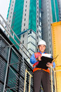 Asian worker or supervisor on building site chinese construction architect with clipboard a in asia Royalty Free Stock Photography