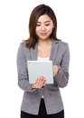 Asian young businesswoman use of the tablet pc isolated on white background Stock Photography