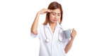Asian young female doctor got headache with a cup of coffee Royalty Free Stock Photo