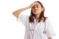 Asian young female doctor got headache. Royalty Free Stock Photo