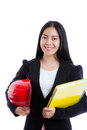 Asian young female holding red hard hat and yellow note book. Is Royalty Free Stock Photo