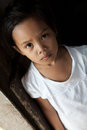 Asian young girl portrait in natural light filipina child from impoverished neighborhood in philippines Stock Images