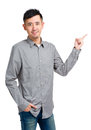 Asian young man pointing aside isolated on white Stock Images