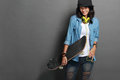 Asian young skater girl holding  a skateboard Royalty Free Stock Photo
