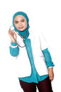 Asian young woman doctor holding a stethoscope on white background Royalty Free Stock Image