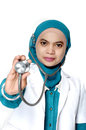 Asian young woman doctor holding a stethoscope on white background Stock Photography