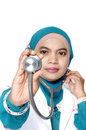 Asian young woman doctor holding a stethoscope on white background Royalty Free Stock Images