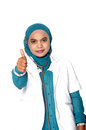 Asian young woman doctor thumbs up on white background Stock Images