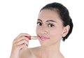 Asian young woman with lipstick in her hand isolated on white background Stock Image