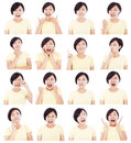 Asian young woman making different facial expressions over white background Royalty Free Stock Images