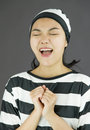 Asian young woman pleading in prisoners uniform Royalty Free Stock Photo