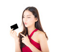 Asian young woman with red dress holding a credit card thinking to spend money lots. Royalty Free Stock Photo