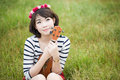 Asian young women with ukulele woman in meadow Stock Photo