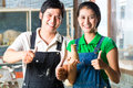 Asians with handmade pottery Royalty Free Stock Photo