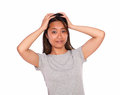 Asiatic charming young female with headache portrait of an on blue jeans and gray t shirt on isolated background Stock Image